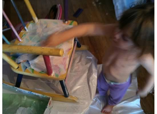 Lo at 2 years old helping me paint her rocker.